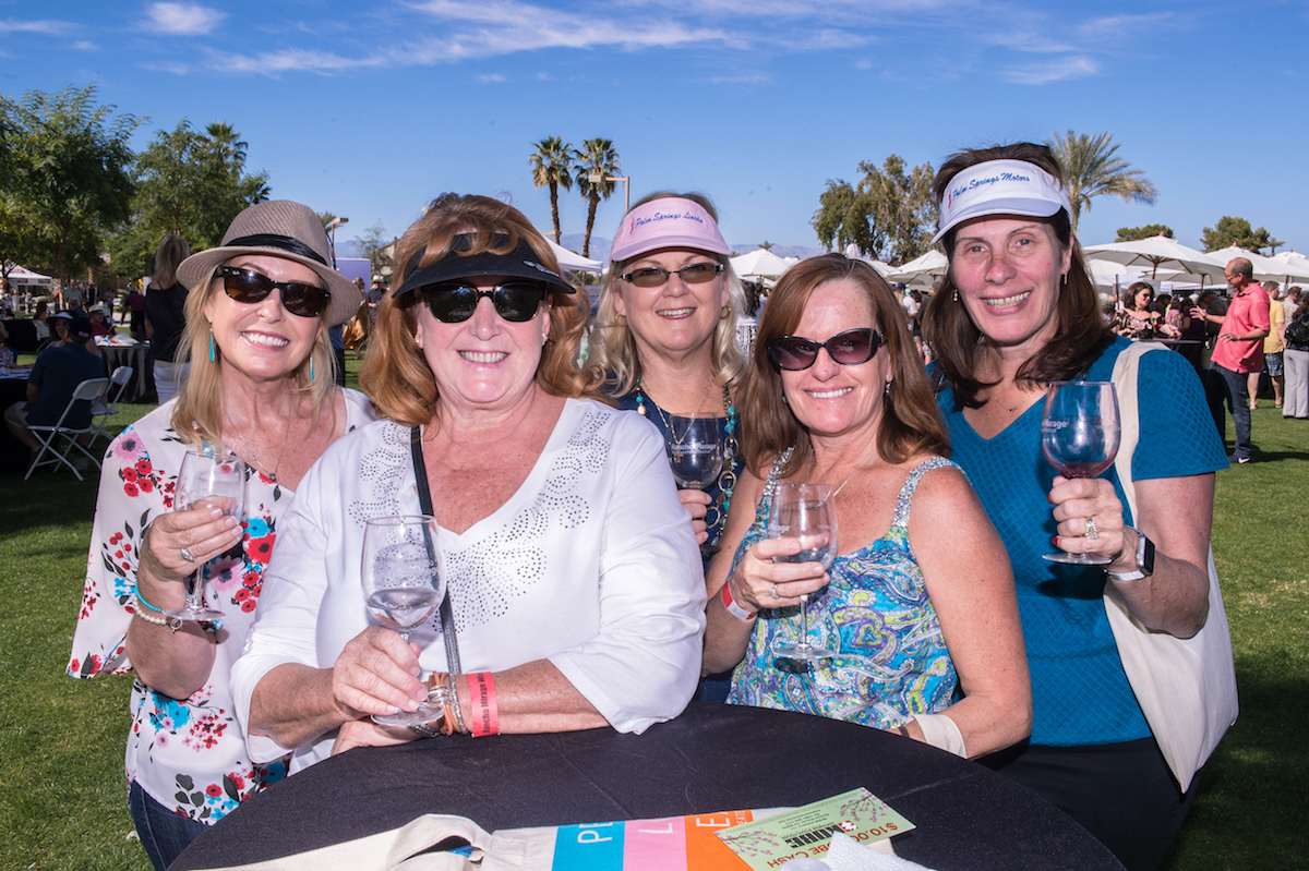 A group at the Rancho Mirage Wine and Food Festival enjoying merlot, chardonney, port, and more