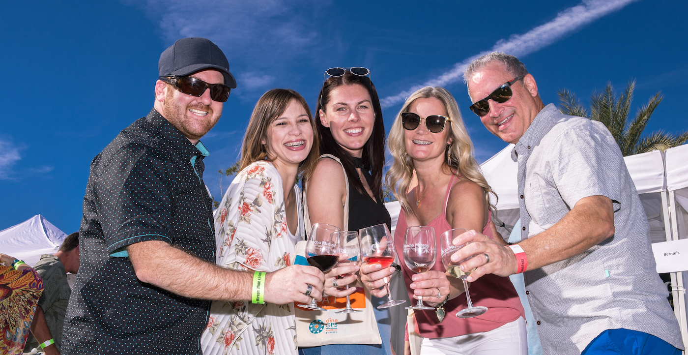 held in a beautiful desert setting, guests enjoy vino at the Rancho Mirage Wine and Food Festival in the Palm Springs area