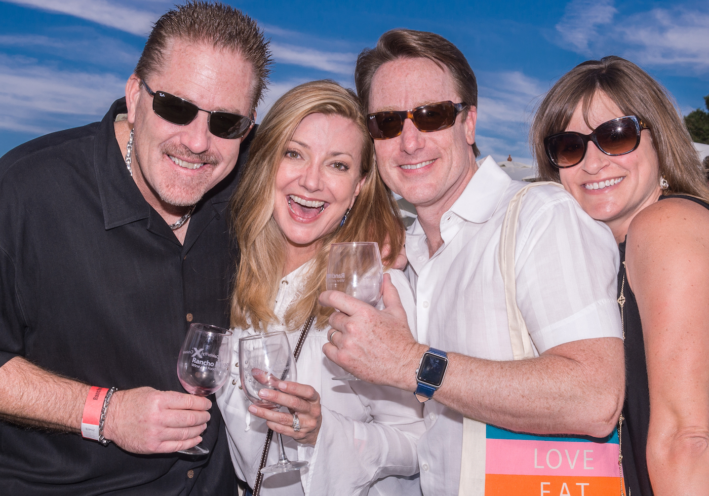 Guest enjoy a sampling of white and red wine at The Rancho Mirage Wine and Food Festival - the Palm Springs Area's Premiere Wine Event